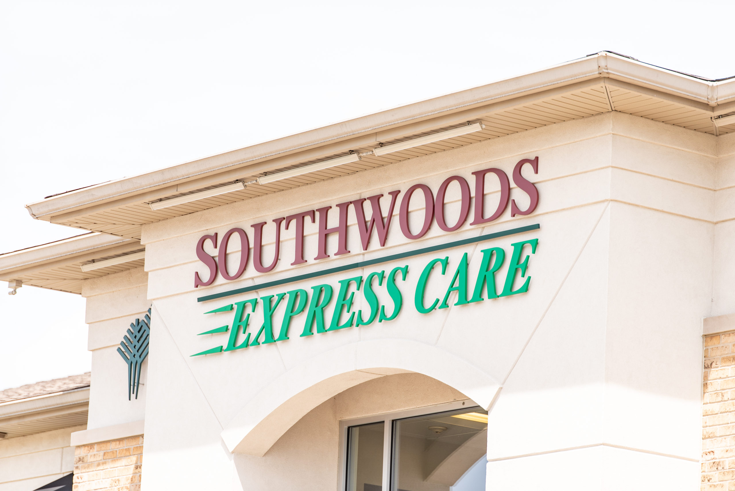 The top of the Southwoods Express Care Building that shows the logo