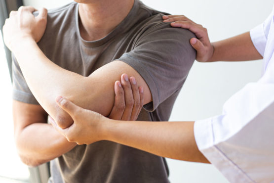 Professional,Therapists,Are,Stretching,Muscles,,Patients,With,Abnormal,Muscular,Symptoms,